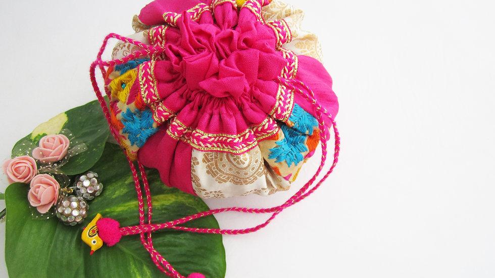 Round Cream and pink Phulkari embroidered potli