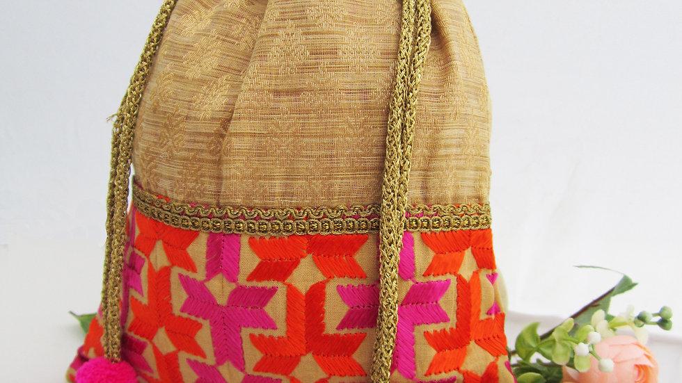 Gold and pink colored Phulkari potli