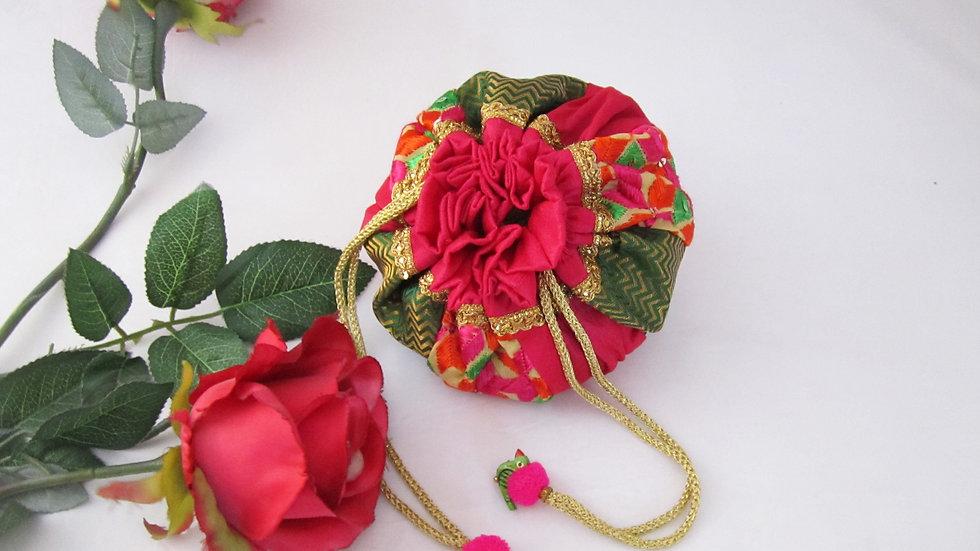 Round Bottle Green and Pink Phulkari embroidered potli