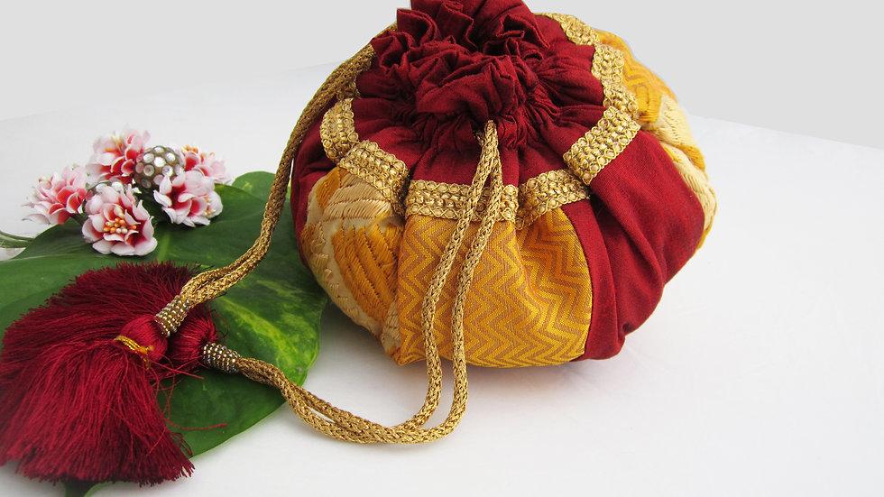Round Yellow gold and Maroon Phulkari embroidered potli