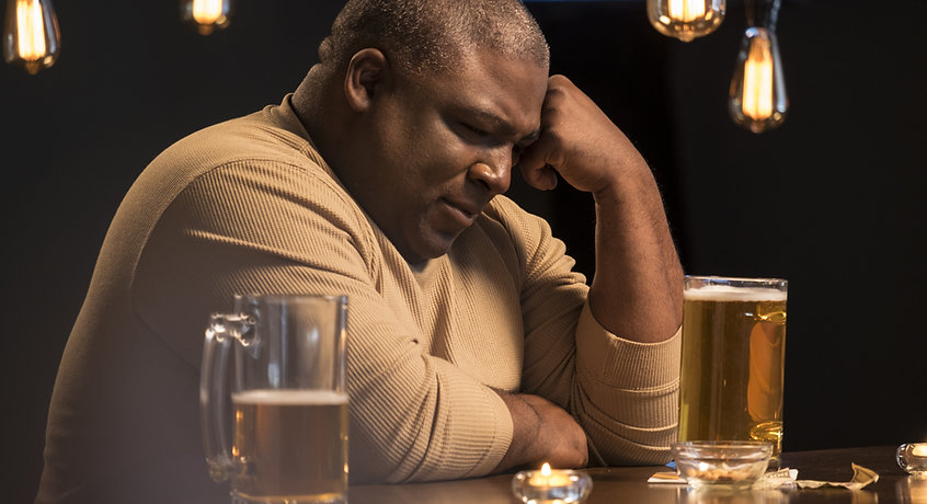 Sad and troubled guy at a bar.jpg