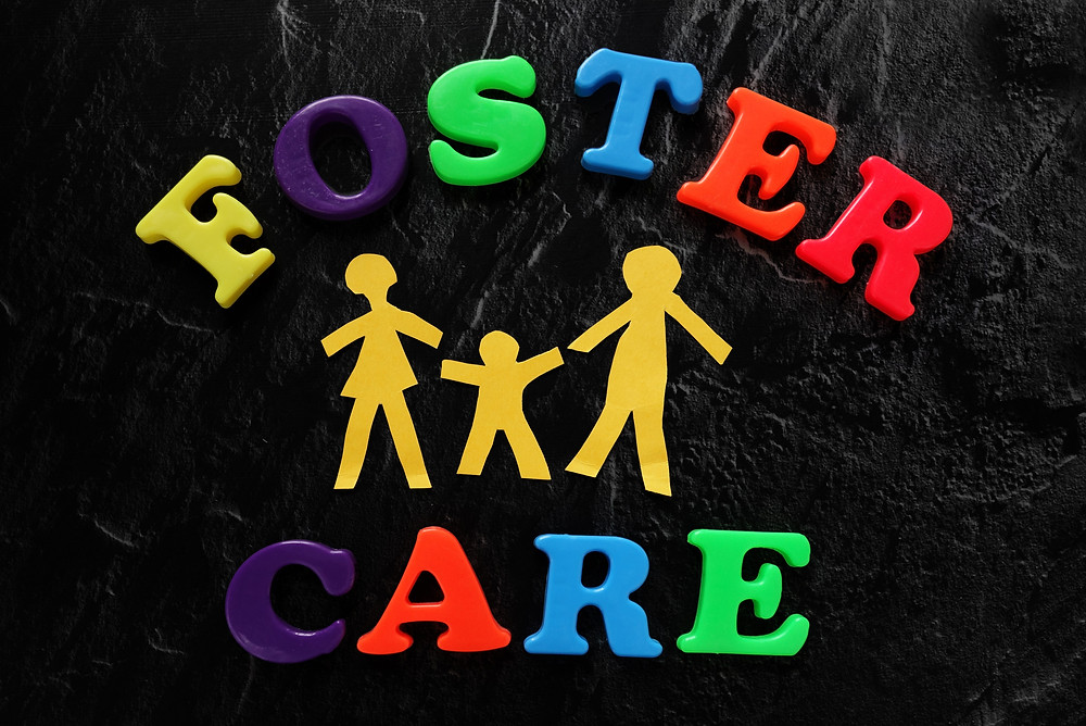 Paper cutout family with Foster Care letters                               .jpg