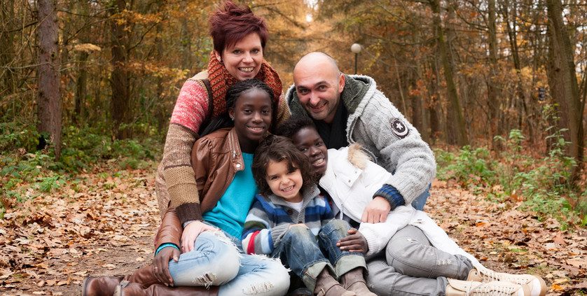 Happy family with foster children in the