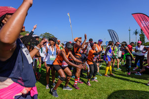 A group of runners celebrating that they made the 3.5 hour time cap for the race.  @TVrugtman | @AdventureLifeSA