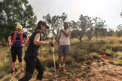 Kane looks on as the runners try Trekking Poles.