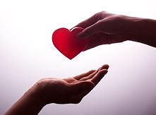 A hand gives a red heart to a hand - blo