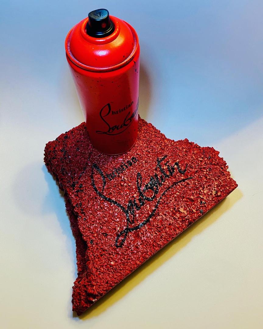 Louboutin spray and brick block