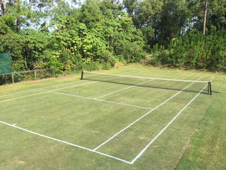 The Frangipani Farm tennis court.jpg