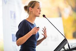 business-woman-speaking-podium-microphon