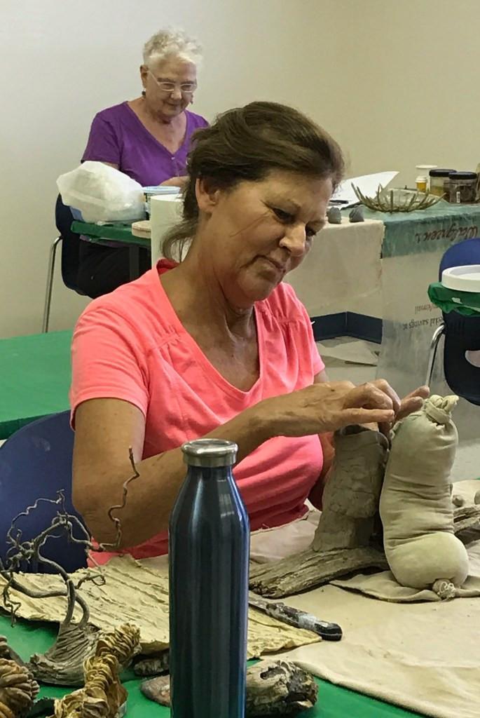Jody Foster working on her creations (Nancy Brandt in background)