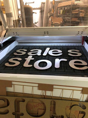 Laser cut black acrylic lettering