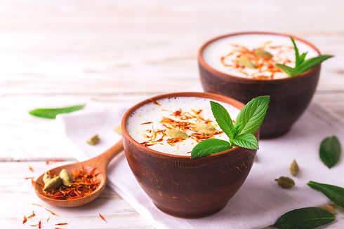 Traditional Indian almond lassi curd wit