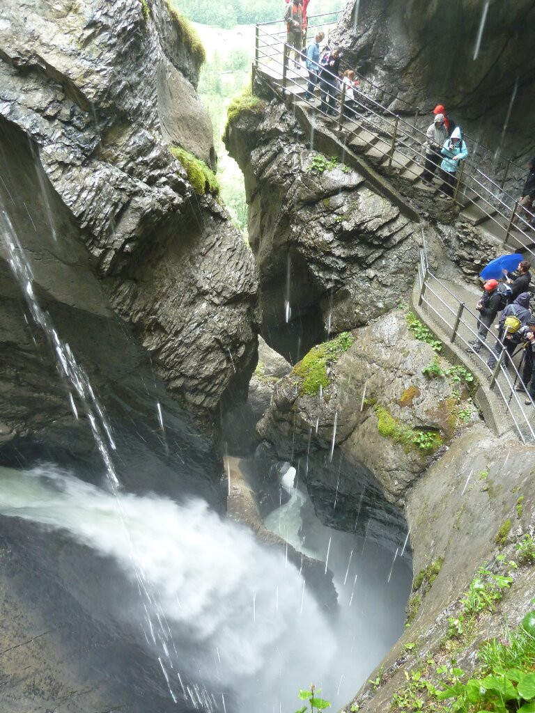Standing inside the Trümmelbach Falls in Switzerland