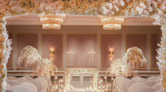 Creating exquisite florals for a ceremony at Four seasons Hotel Hampshire, photography by Richard Waite
