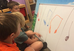 children drawing music notes