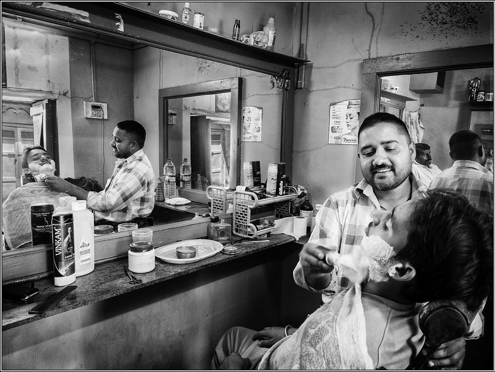 MONO - Barber shop, Varanasi by Ian O'Neill (17 marks)