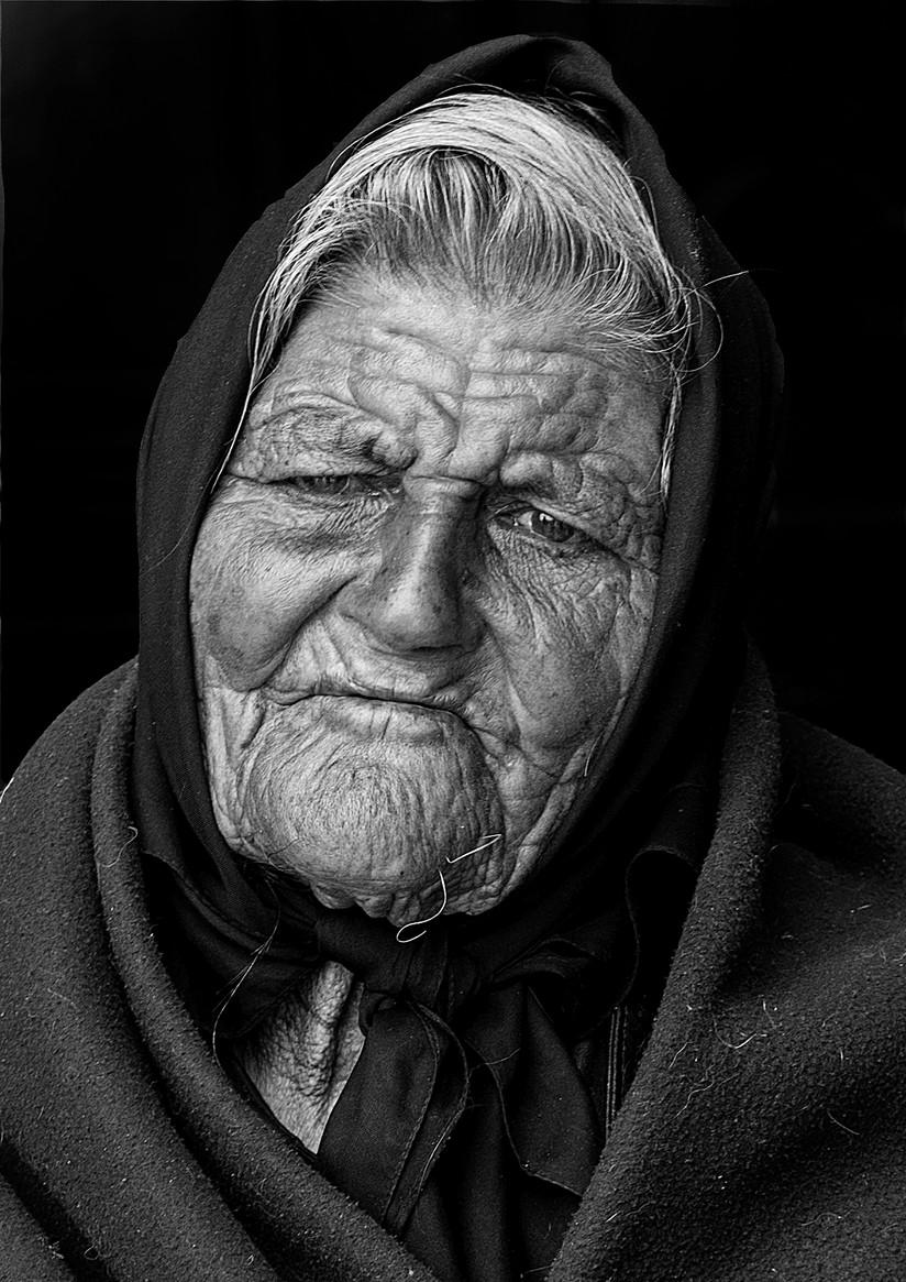 MONO - Portuguese Beggar Lady by Raymond Hughes (9 marks)