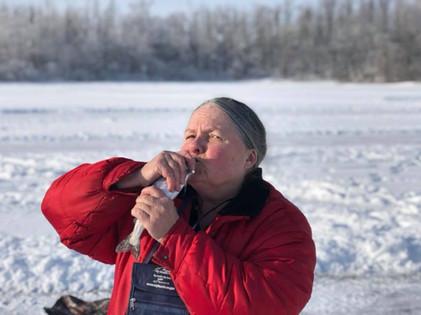 Veteran kissing a fish