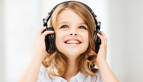 Canva - Little Girl with Headphones at H