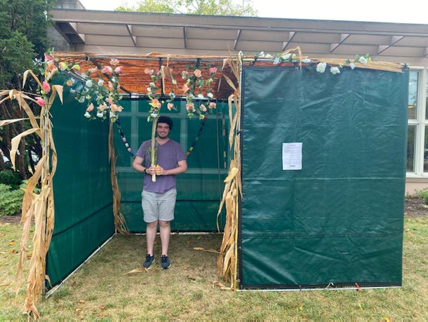 Jonah shakes the lulav in our Sukkah