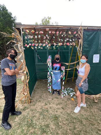 Sukkah set up with Isabel, Mikey, and Sam.