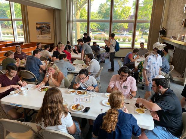Shabbat dinner of people eating.jpg