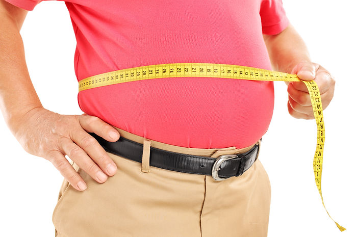 Fat mature man measuring his belly with