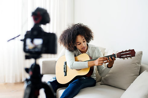 female-vlogger-recording-music-related-b