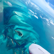 Flying over the Exuma Island Chain of the Bahamas