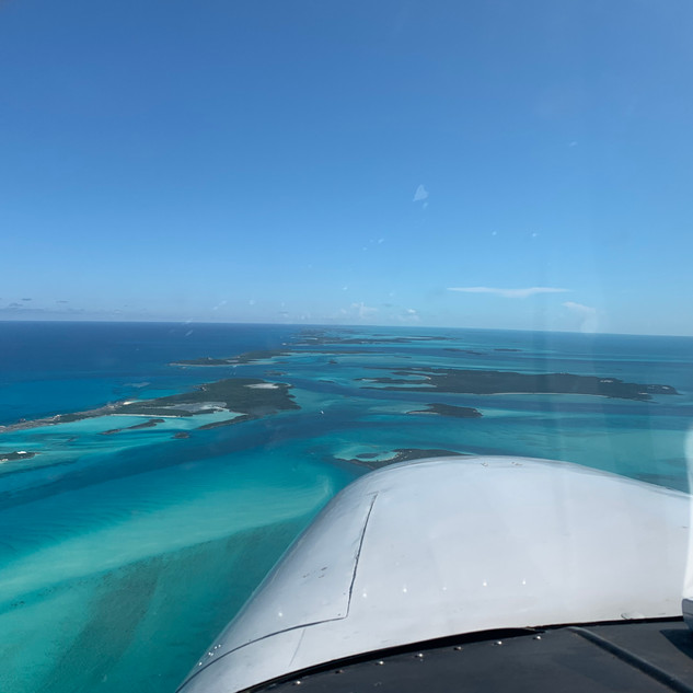 Flying South down the Exuma Chain in the Bahamas