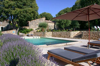 Swimmig pool surrounded bu stone walls in Provence