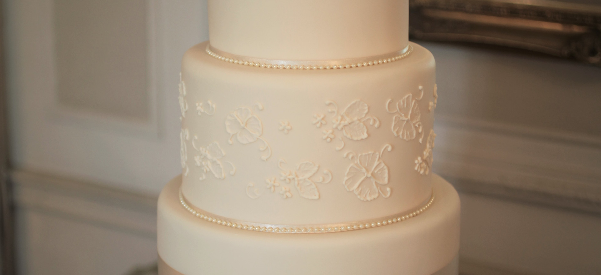 Ivory cake with piped detail