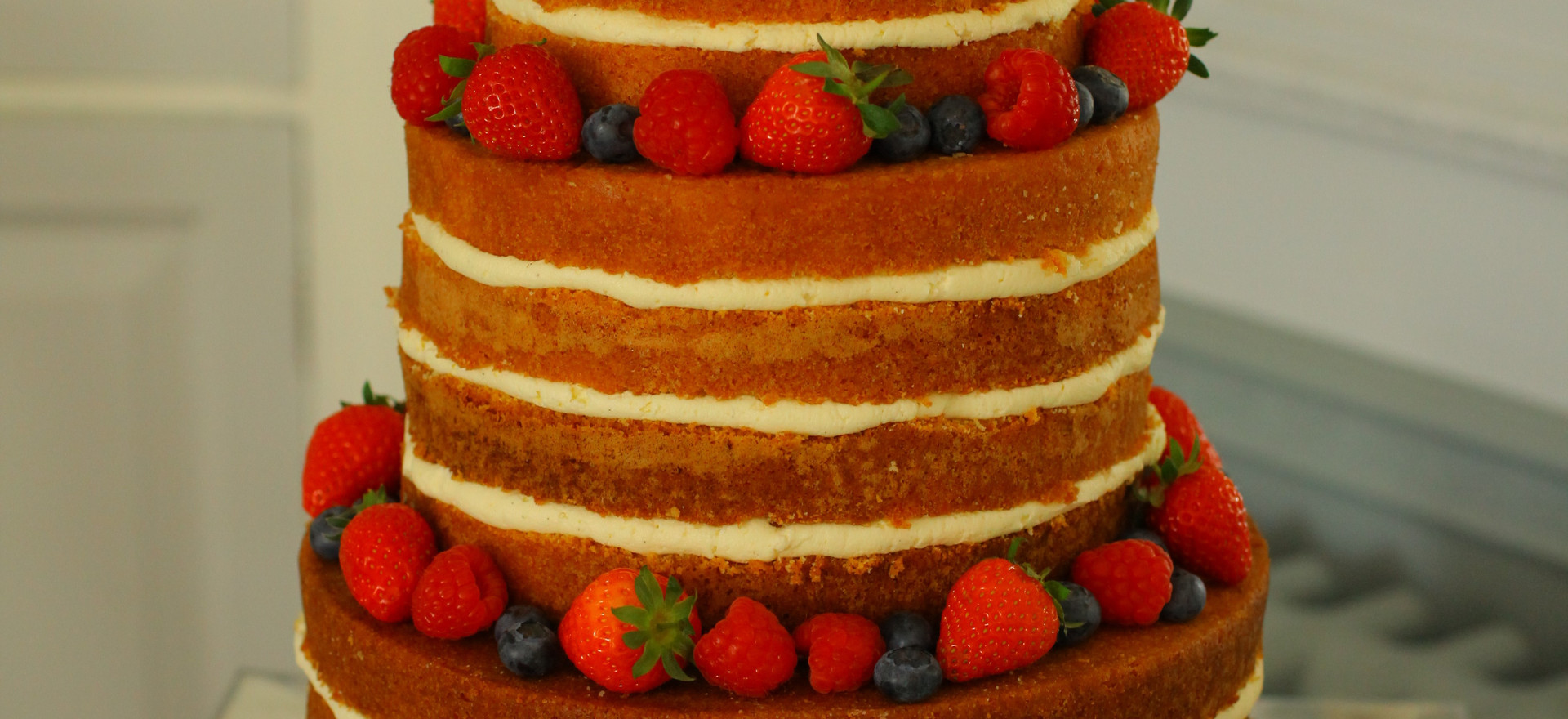 'Naked' cake with fresh summer fruits