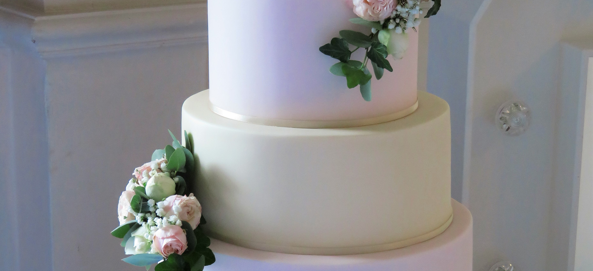 Pink and ivory cake with fresh flowers