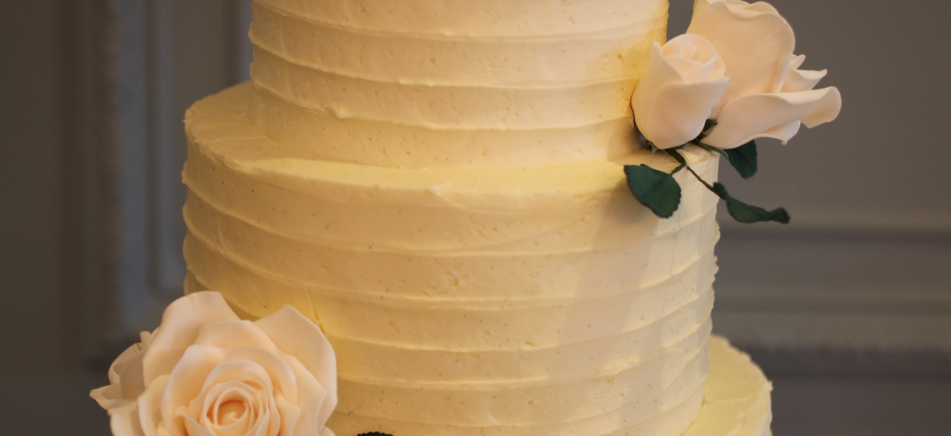 Ivory textured buttercream with sugar roses