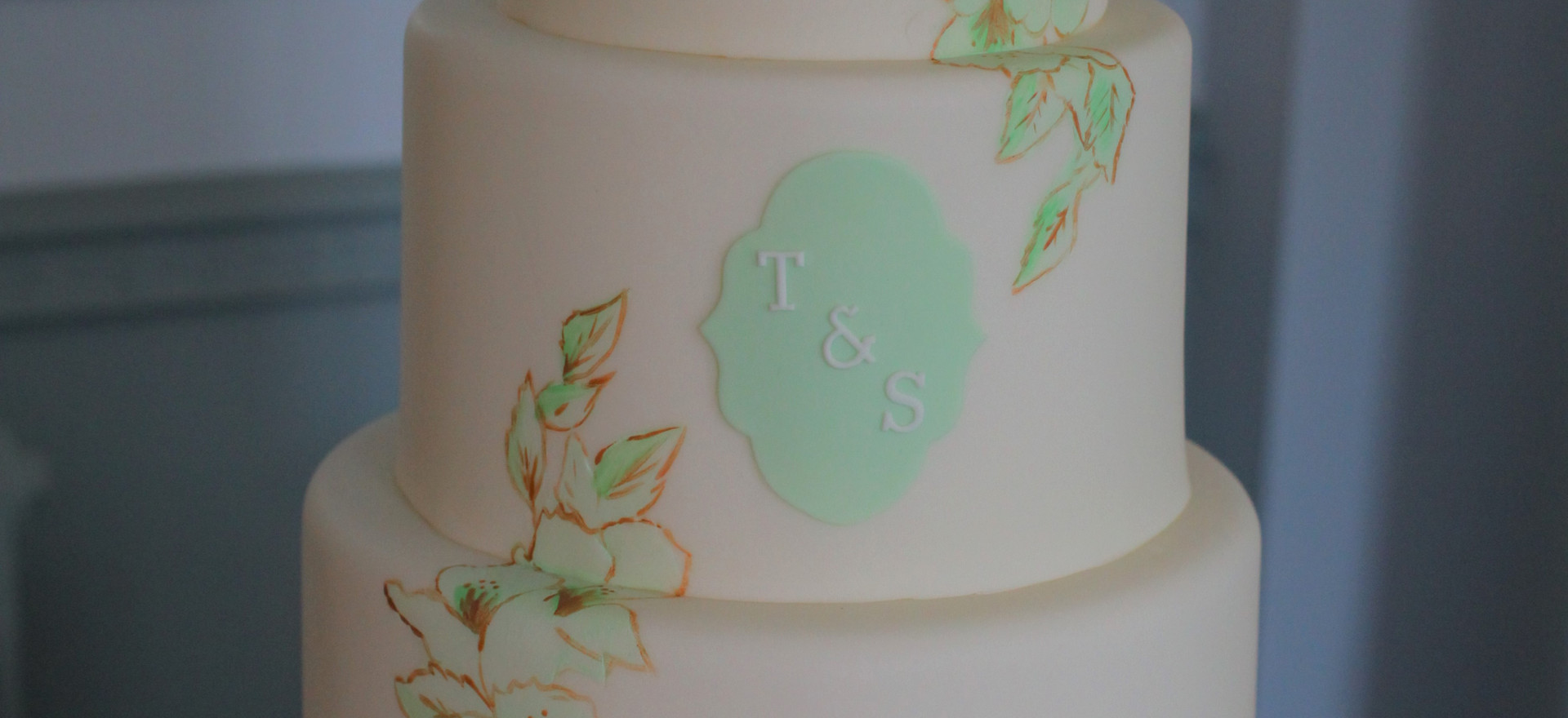 Hand painted cake with monogram plaque
