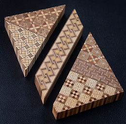 Natural wood colors woven together in geometrical patterns become Seed Wood Block