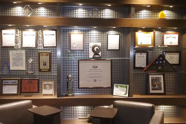 Hydro-Thermal's wall dedicated to its many awards and achievements