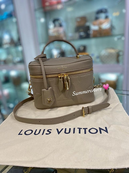 Louis Vuitton vanity case in taupe