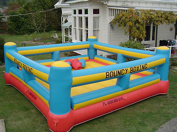 Bouncy Boxing Ring with Giant Gloves