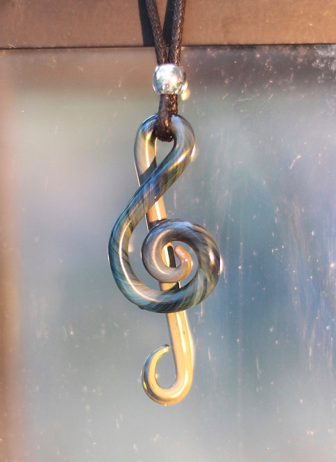 Glass treble clef pendant