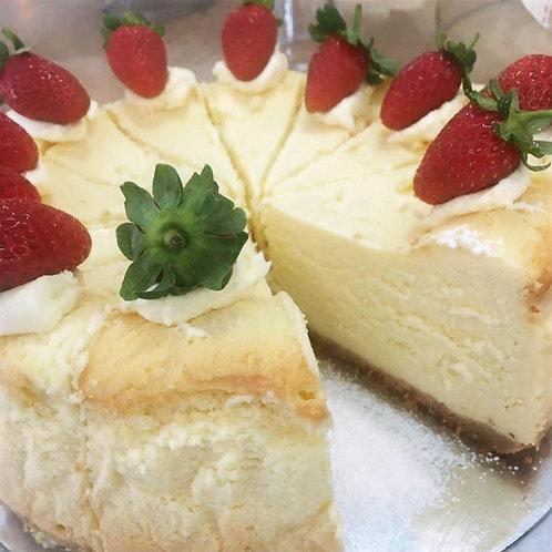 White Chocolate Cheesecake with Cream and Strawberries