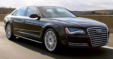 cost effective luxury big black Audi A8 chauffeur car to the airport from Swindon