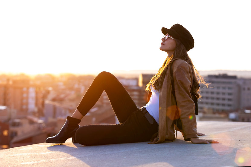 pretty-young-woman-enjoying-time-and-sun