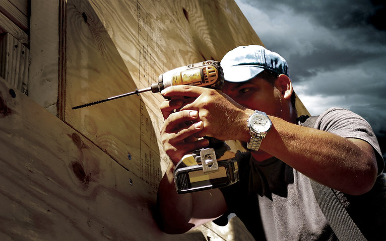 Contractor using SIP Screw from TRUFAST Walls to attach Structural Insulated Panel