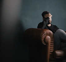 Thinking Man on Couch.webp