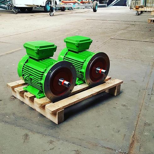 2 Green Marine boat motors on a pallet
