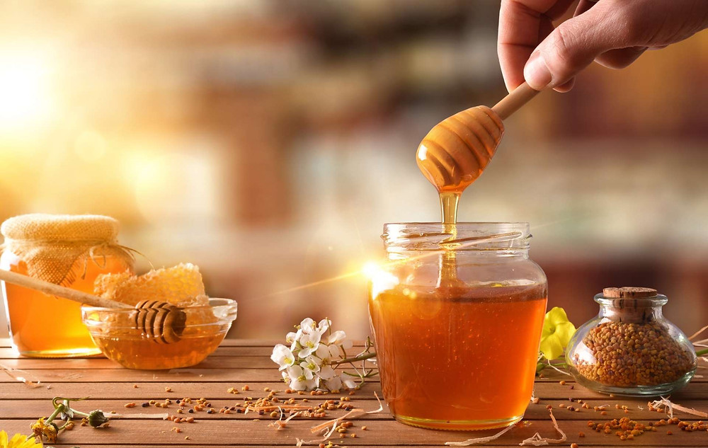 How can I restore honey to a liquid form