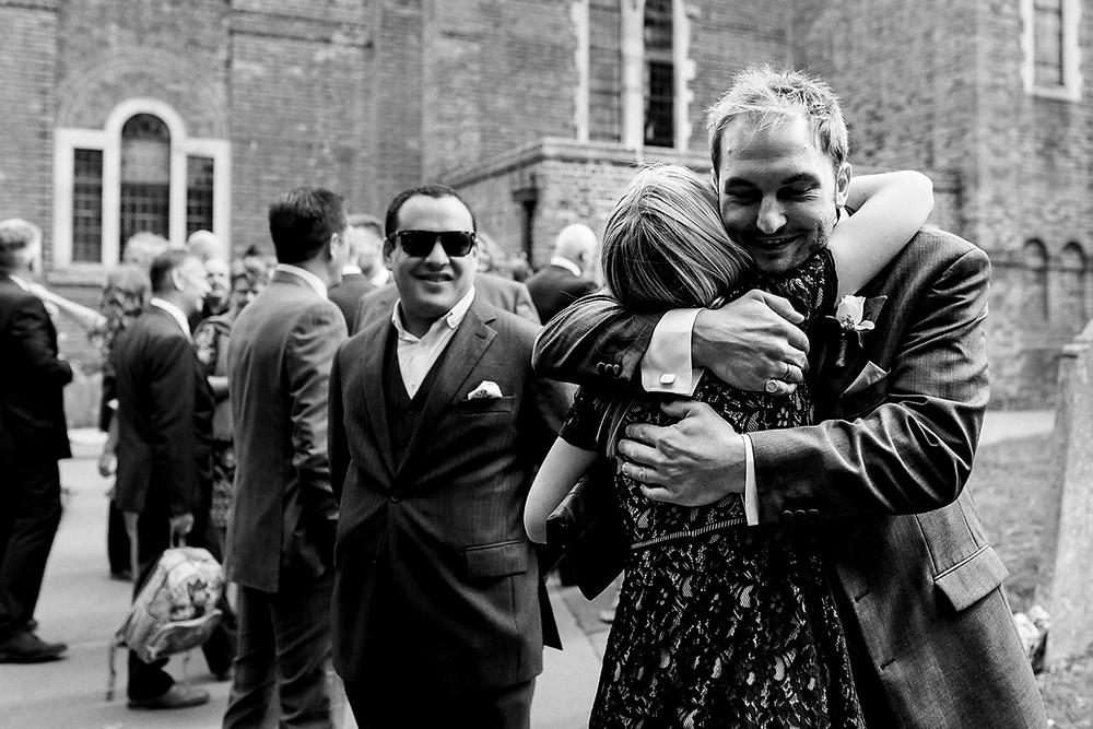 groom hugging a guest