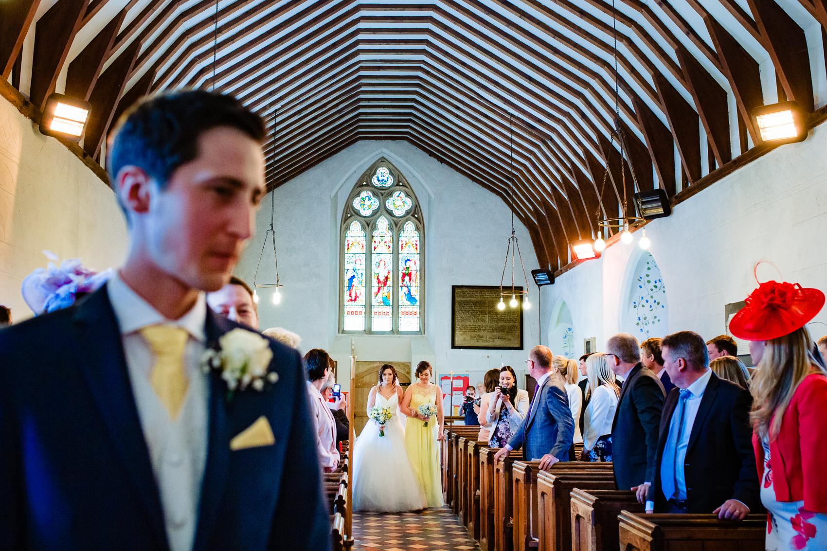 Bride wlaking down the aisle at St Leonard's Church Sherfield on Loddon